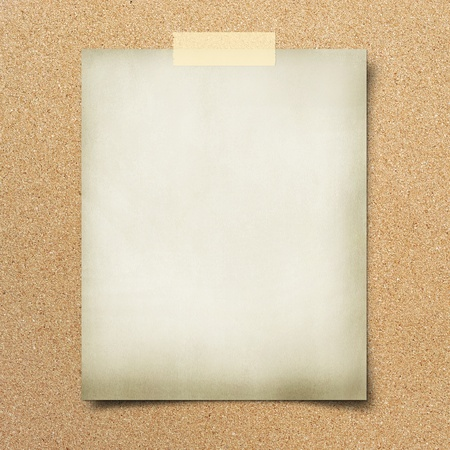 thumbtack: note paper  on cork board background Stock Photo