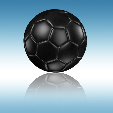 soccer football with reflection on a blue background photo
