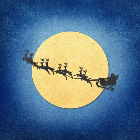 Santa Claus On Sledge With Deer And Moon  recycled papercraft Stock Photo - 10338100