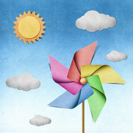 pinwheel: windmill recycled papercraft on paper background Stock Photo