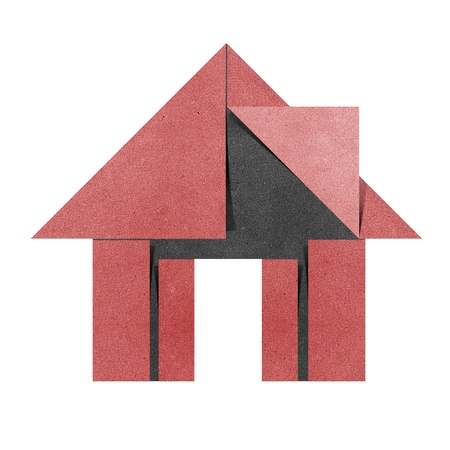 craft materials: House origami recycled papercraft on white background