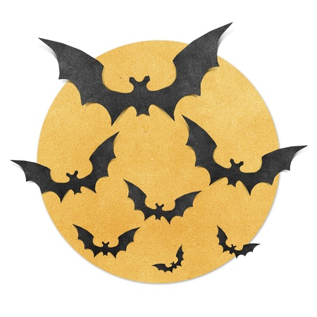Halloween bat and full moon recycled papercraft background photo