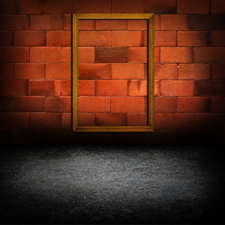 picture frames on red brick wall photo