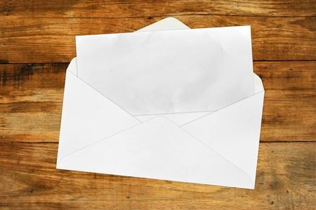 Vintage Envelope with blank Brown paper on wood photo