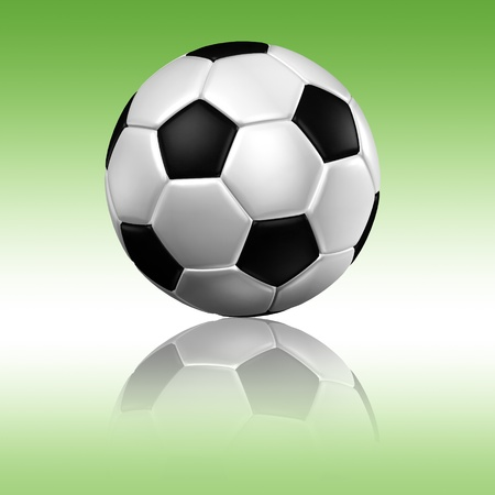 a soccer football with reflection on a green background photo