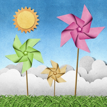 windmill on grass field recycled papercraft  background photo