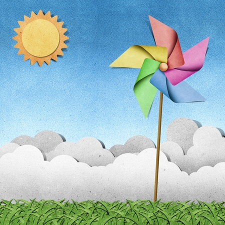 papercraft: windmill on grass field recycled papercraft  background