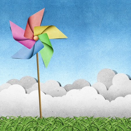 pinwheel: windmill on grass field recycled papercraft  background