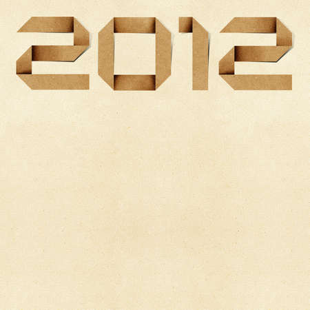 Happy new year 2012  Recycled PaperCraft Background. photo