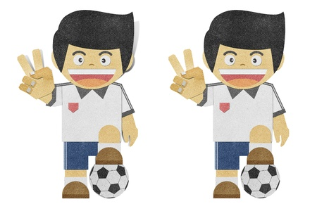Paper boy  ( football player ) recycled papercraft  on white background photo