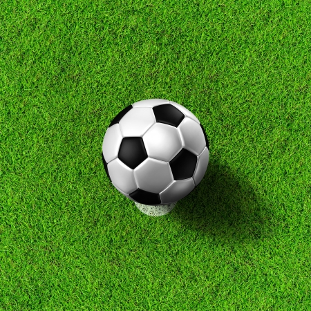 Football   soccer  ball   in green grass field Stock Photo - 13700764