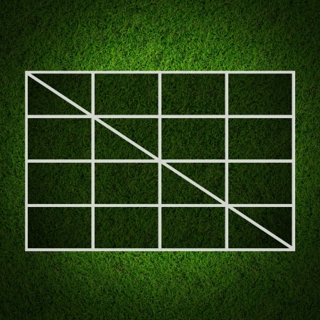 Blank  3x3 Table score on grass field. photo