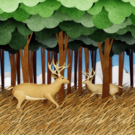 wood craft: Deer made from recycled paper background Stock Photo