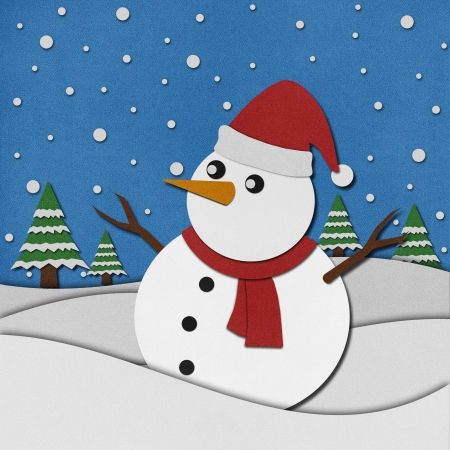 Snowman recycled papercraft on paper background. Stock Photo - 15764596
