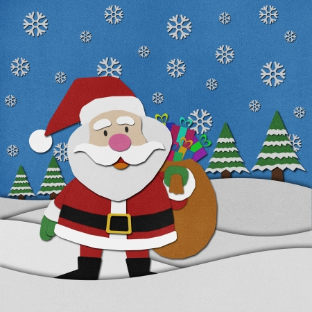 Santa claus recycled papercraft on paper background  photo