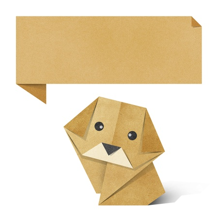 Origami dog recycled paper background photo