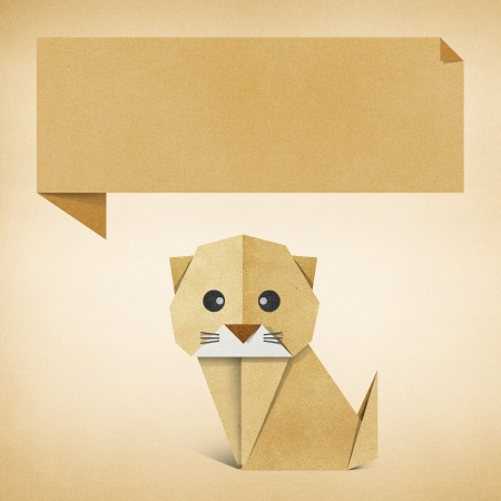 Origami cat recycled paper background photo