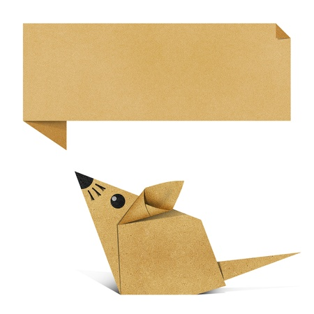 Origami rat recycled paper background photo