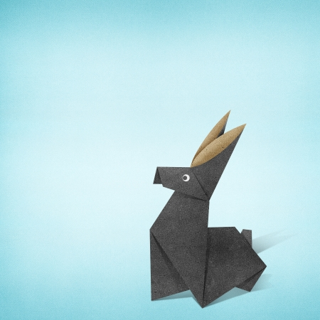 Origami rabbit recycled paper background