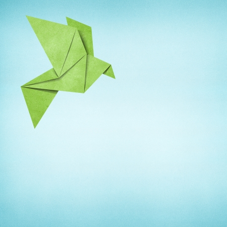 Origami bird recycled paper background photo