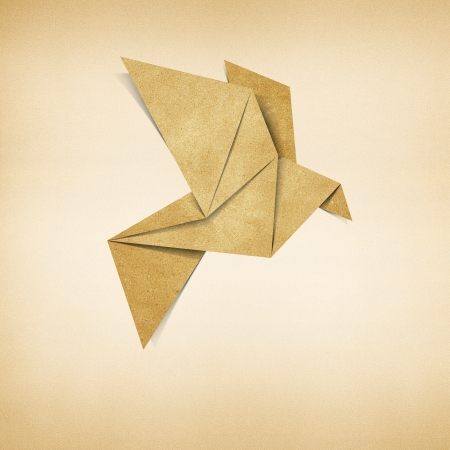 Origami bird recycled paper background Stock Photo - 17018342