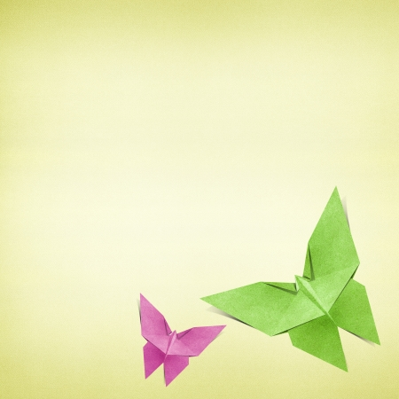 butterfly hand: Origami butterfly recycled paper background