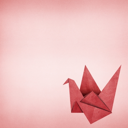 Origami bird recycled paper background Stock Photo - 17018341