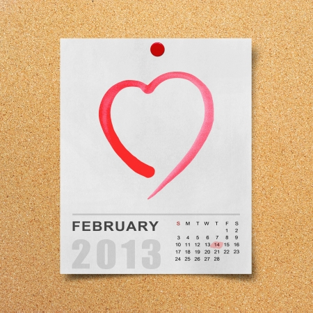 Calendar 2013 and red heart on note paper background  photo