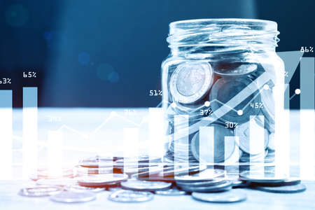 Coins in the glass. Saving money for finance accounting.Financial investment with graph background concept. 3d rendering Фото со стока