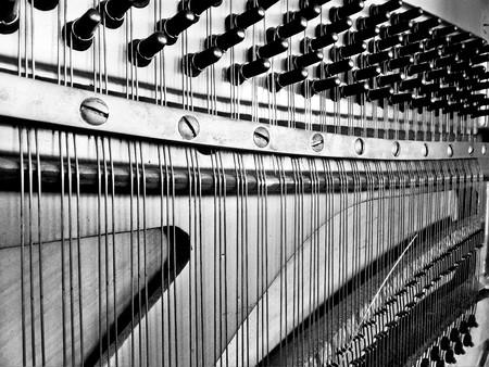 rupture: Piano wire breaking shear black and white Stock Photo