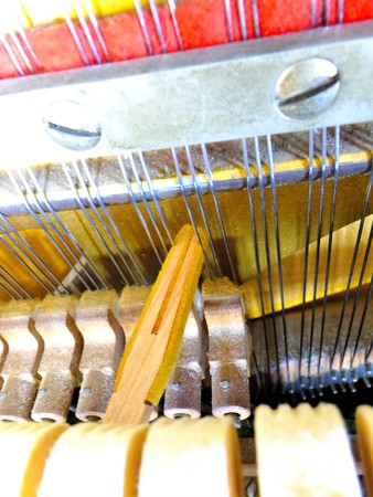 replacing: Replacing the strings of the piano