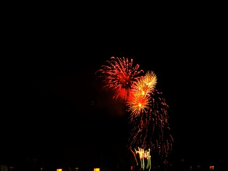 detonating: Fireworks. Enjoy the beautiful colors and shapes by detonating explosives launched into the night sky.