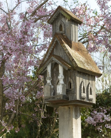 Homemade Bird House in a turn-of-the-century style in a turn-of-the-century history neighborhood