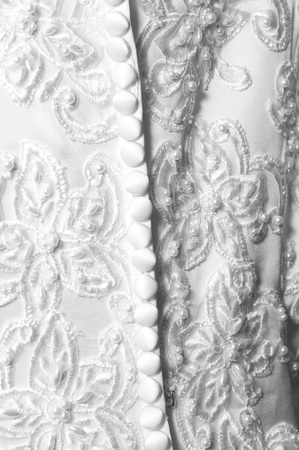bodice: Bodice back of white wedding dress with many buttons