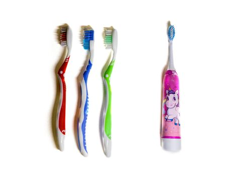 toothbrushes three mechanical and one electric