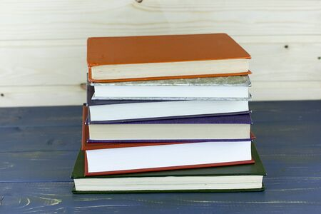 A pile of books with library on the back