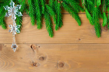 Christmas composition: Fresh branches of blue spruce with cones on aged wooden background. Top view.