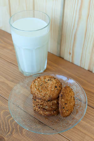A few stacks of cookies and a glass of fresh milk.