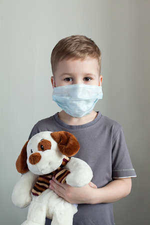 Portrait of kid with face mask, isolated on white background. Zdjęcie Seryjne