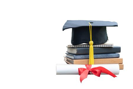 Close up black graduation cap and certificate paper with red ribbon on a stack of vintage books isolated on white background. Education celebration for graduation day concept. di cut