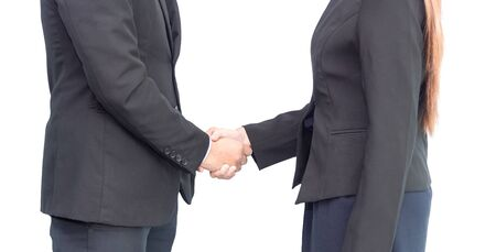 Close up of businesswoman and businessman shaking hands for agreement project during board meeting isolated on white background. Business people partnership, business success smart deal concept Zdjęcie Seryjne
