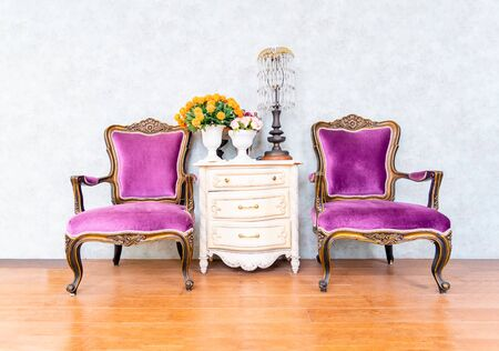 Two purple armchairs sofa couch classical style  and vintage white wooden , retro furniture and decoration in living room. Reklamní fotografie