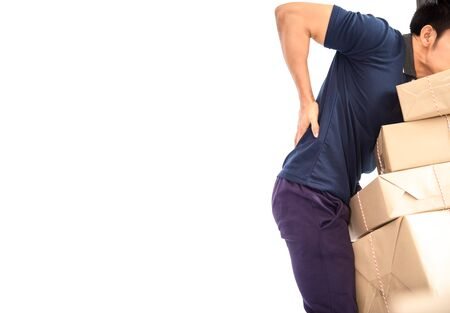 Worker courier male mover holding package parcels boxes with backache while lifting brown card boxes isolated on white background .Delivery concept Stockfoto