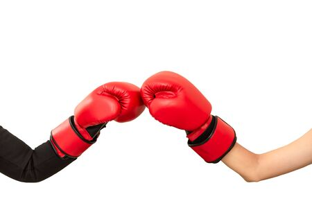 Two hands wear red boxing gloves punching ,fighting strategy business and creative ideas isolated on white .Competition in the new business concept