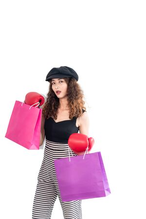 Young confident crazy asian woman wearing red boxing gloves and holding shopping bag isolated on white background. Shopping summer day ,knockout sale fashion concept.