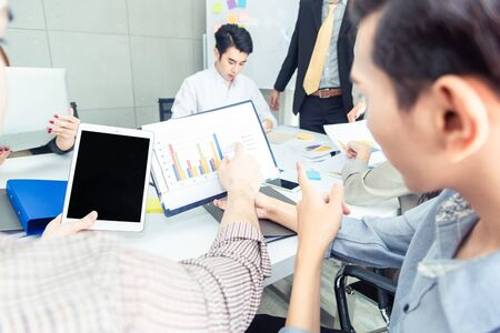 Teamwork business concept .Start up business people in modern office, working together having success. Multiethnic start-up business team on meeting in modern bright office interior brainstorming Imagens