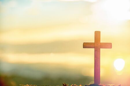 Wooden cross at sunrise in morning time with holy and light background .Crucifixion of jesus christ sign catholic religion concept