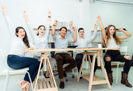 Teamwork of young asian business people working success smart deal and celebrate in modern office.Togetherness happiness colleagues people business group ,celebration success for work concept Imagens