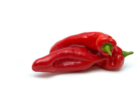 red peppers: Two isolated hot red peppers