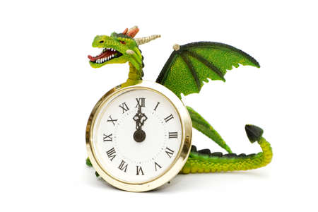 whote: Dragon and clocks isolated on white